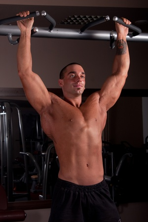 Bodybuilder exercising in a gym photo
