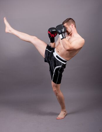 kick-boxer training before fight photo