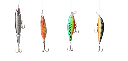 rapala: Five fishing lures -floating wobblers hanging in front of white background