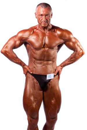 bodybuilder posing over white background  Stock Photo - 8767888