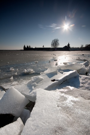 cracked ice on lake Balaton photo