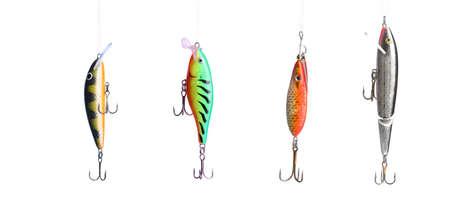 allurement: Five fishing lures -floating wobblers hanging in front of white background