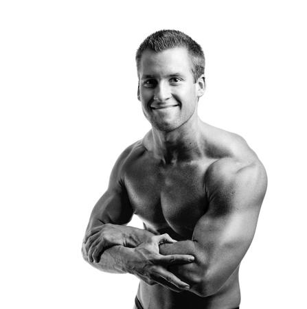 amateur bodybuilder posing over white background Stock Photo - 9088475