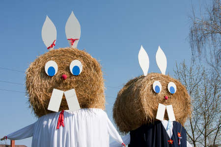 snooping: easter rabbit from hay bale Stock Photo