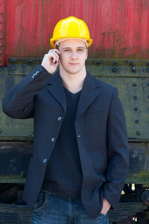 young engineer standing in front of old train photo
