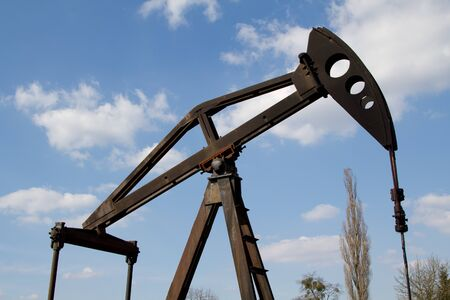 Working oil pump with blue sky photo