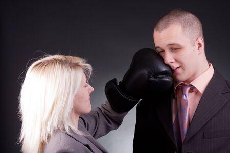 agressive: young agressive businesswoman hit businessman