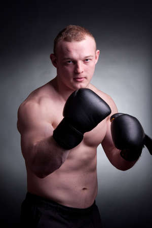 young man with boxing gloves Stock Photo - 9470464