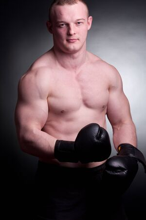 asian bodybuilder: young man with boxing gloves