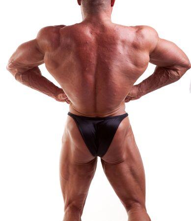 bodybuilder posing over white background   photo