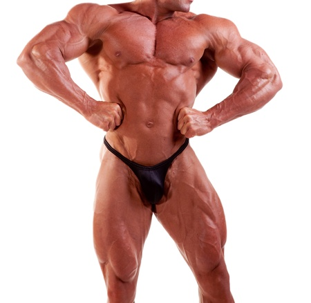bodybuilder flexing his muscles isolated on white   photo