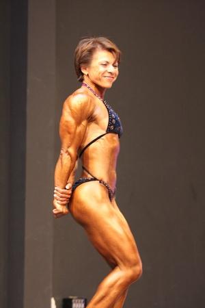 BUDAORS, HUNGARY - JUNE 11: Rosmarytsia Oksana participates in WBPF bodybuilding European championship women's bodybuilding category on June 11, 2011 in Budaors, Hungary Stock Photo - 9768342