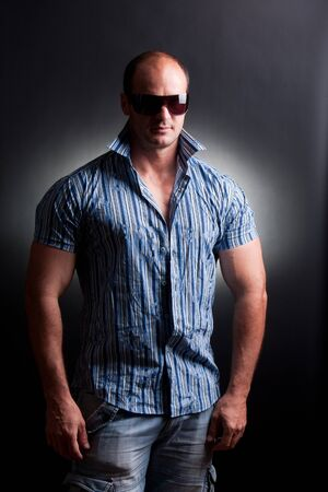 cool mature man posing in studio photo