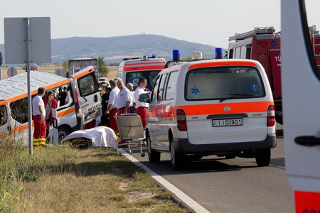 cs: PÉCS, HUNGARY - SEP 15: Firefighters help the victim of car accident on Sep 15, 2011 on Road 6 in Pécs, Hungary. Editorial