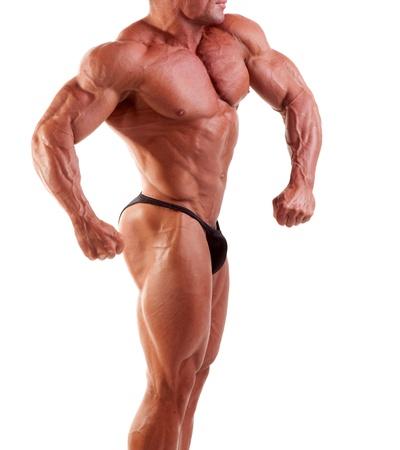 Bodybuilder zeigt seine Muskeln, isoliert auf weiss   Lizenzfreie Bilder