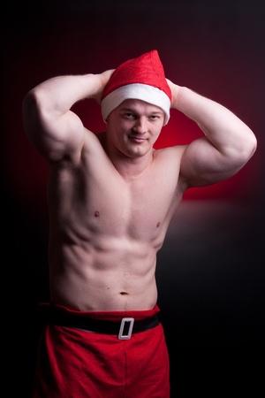 tricep: muscular santa claus posing in studio Stock Photo