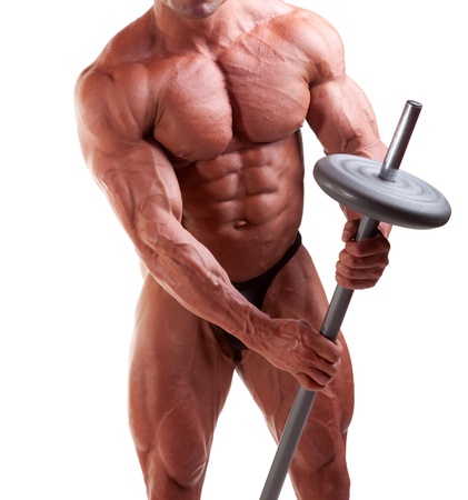 Bodybuilder exercising in front of white background photo