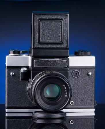 ttl: medium fomat camera with blue background Stock Photo