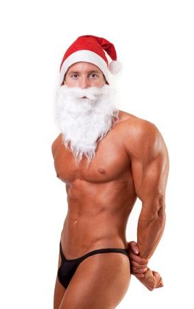 bodybuilder santa claus posing over white photo