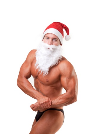 bodybuilder santa claus posing over white photo