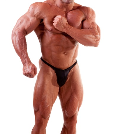 male bodybuilder: bodybuilder flexing his muscles isolated on white