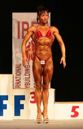 body builder: KOPER - NOVEMBER 13: Grof Brigitta participates in IBFF Bodybuilding world championship Miss Figure category on November 13, 2010 in Koper, Slovenia Editorial