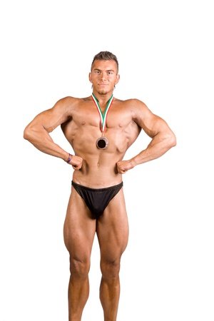 young bodybuilder champion posing over white background photo