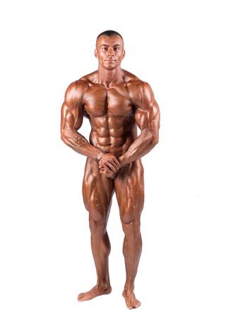 Bodybuilder seine Muskeln spielen im Studio Standard-Bild - 11110938
