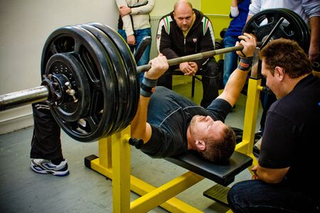amateur: PECS - JANUARY 29: Unknown man participates in Amateur bench press championship in Professors GYM January 29, 2011 in Pecs, Hungary. Editorial