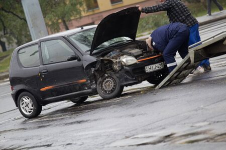 smashup: PECS, HUNGARY - OCT. 21: For car crashed. Repairmans try to help the victim of car accident on Oct 21, 2011 on Road 6 in Pecs, Hungary.