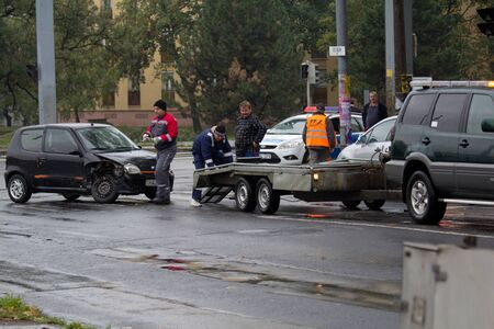 PECS, HUNGARY - OCT. 21: For car crashed. Repairmans try to help the victim of car accident on Oct 21, 2011 on Road 6 in P�cs, Hungary.