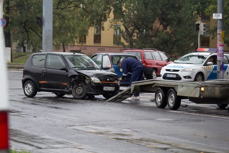 PECS, HUNGARY - OCT. 21: For car crashed. Repairmans try to help the victim of car accident on Oct 21, 2011 on Road 6 in Pécs, Hungary.