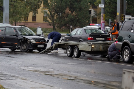 negligent: PECS, HUNGARY - OCT. 21: For car crashed. Repairmans try to help the victim of car accident on Oct 21, 2011 on Road 6 in P�cs, Hungary.