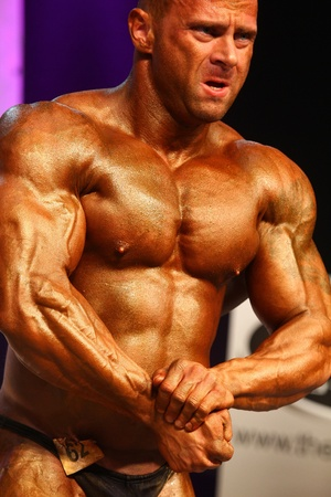 pectorals: bodybuilder posing in a competition Editorial