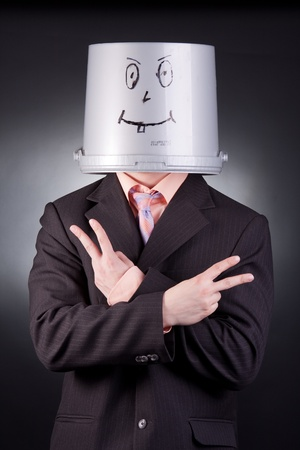 funny businessman with a bucket on his head photo