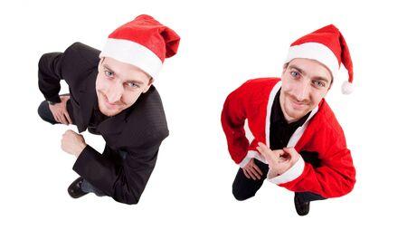 two young man wearing santa hat photo