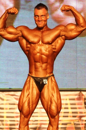 BUDAPEST - NOVEMBER 20: Molnar Peter participate in IFBB Champion of the Year 2011 bodybuilding championship Overall category on November 20, 2011 in Budapest, Hungary