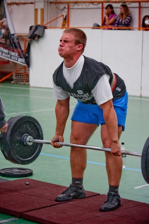 barbel: PECS - OCTOBER 16: Unknown man participates in Brutal Challenge power lifting championship October 16, 2010 in Pecs, Hungary.