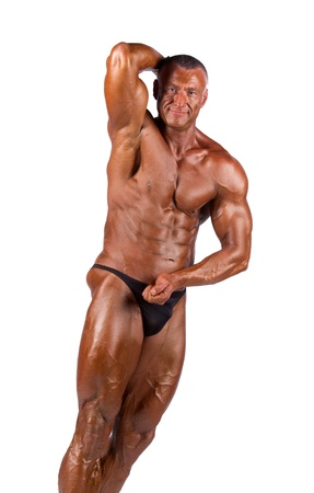 pectorals: bodybuilder flexing his muscles in studio Stock Photo