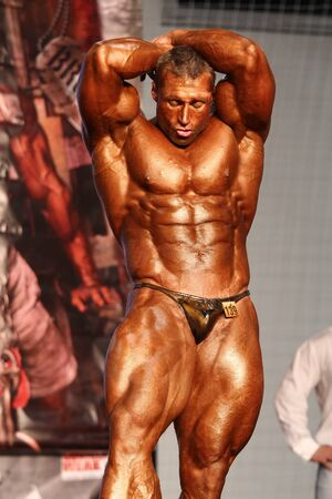 BUDAPEST - NOVEMBER 20: Kormany Mihaly participate in IFBB Champion of the Year 2011 bodybuilding championship Overall category on November 20, 2011 in Budapest, Hungary