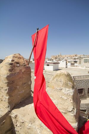 detail of Medina in Sousse, Tunisia with flag photo