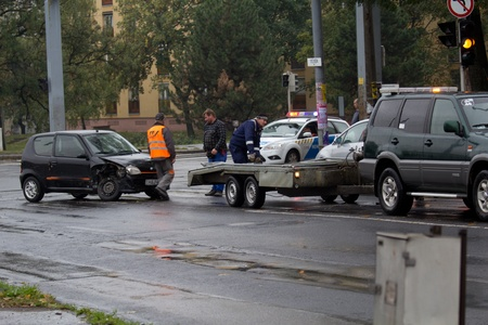 negligent: PÉCS, HUNGARY - OCT. 21: For car crashed. Repairmans try to help the victim of car accident on Oct 21, 2011 on Road 6 in Pécs, Hungary.