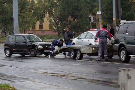 PÉCS, HUNGARY - OCT. 21: For car crashed. Repairmans try to help the victim of car accident on Oct 21, 2011 on Road 6 in Pécs, Hungary.