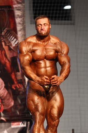 BUDAPEST - NOVEMBER 20: Kormany Mihaly participate in IFBB Champion of the Year 2011 Overall category on November 20, 2011 in Budapest, Hungary Stock Photo - 11565645
