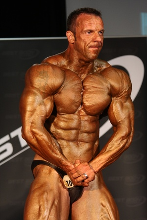 BUDAPEST - JUNY 18:Erno Reichardt participates in WABBA bodybuilding world championship Masters category Juny 18, 2011 in Budapest, Hungary Stock Photo - 11593930
