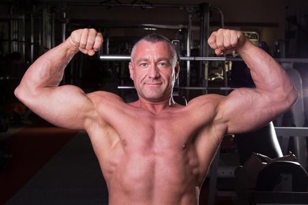 testosterone: bodybuilder posing in a gym