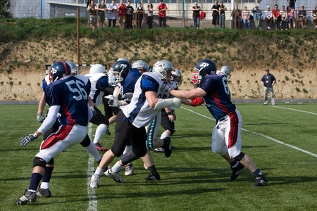 KOZARMISLENY - APRIL 4: Zala Predators (blue) and Pecs Gringos (white) american football teams participate in Hungarian Championship, April 4, 2009 in Kozarmisleny, Hungary.