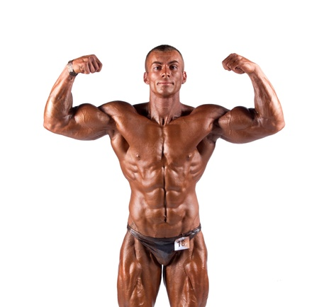 bodybuilder flexing his muscles in studio photo