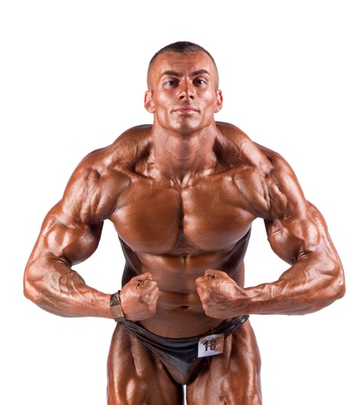 muscular body: bodybuilder flexing his muscles in studio Stock Photo