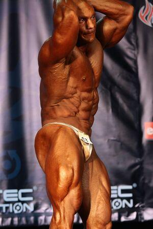 BUDAPEST - JUNE 18:Kokeny Bela participates in WABBA bodybuilding world championship Man Short category June 18, 2011 in Budapest, Hungary Stock Photo - 12073985